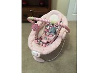 Comfort & Harmony pink baby bouncer with vibration & lullabies