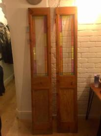 Two beautiful wooden double doors. Coloured glass panels.