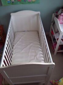 Cot that converts into a bed