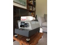 Vintage slide projector and screen