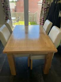 Solid wood dining room table and chairs.