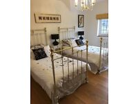2 brass and cream single bed frames