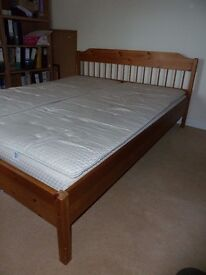 king size double bed - wooden frame and slats with mattresses and padded mattress protectors