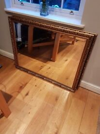 large gold framed mirror