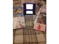Nintendo ds with charger and games perfect condition.