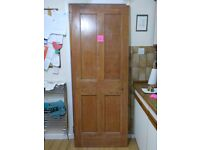 ANTIQUE WOODEN PANELLED DOORS. RECLAIMED PANEL PINE DOOR. SALVAGE UP-CYCLE RECYCLE.