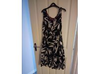 Reversible dress. Joe Browns dress size 10 but fits like size 12. Polyester.