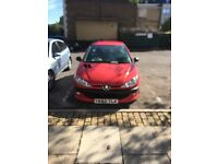 Red Peugeot 206 XSi for sale in Twickenham. 95,000 miles, good clean car, well maintained.