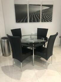 4 seater glass dining table and 4 faux leather chairs