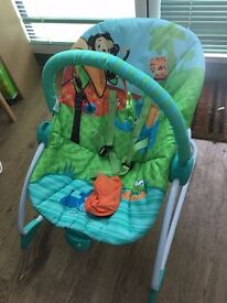 Baby Bouncer with straps and dangling toys. Will bounce or vibrate (battery powered)
