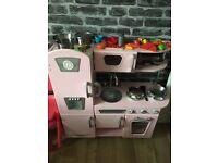 Child's Pink Kidcraft Toy Kitchen with accessories