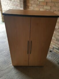 A large practical dresser for sale with an opening door that is practical for everything