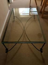 Glass on metal frame coffee table