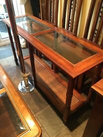 Tall slim table. Wooden and glass.