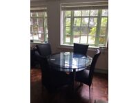 Glass Kitchen/Dining Table and 4 Black Faux Leather Chairs