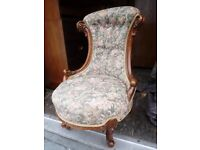 Antique Victorian mahogany carved nursing chair