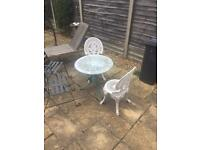 Garden table with two matching chairs