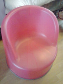 large plastic kids seat in pink plastic