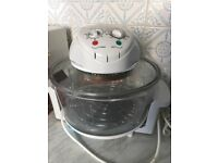 Electric halogen oven plus accessories and cookbook. Used twice. In excellent condition.