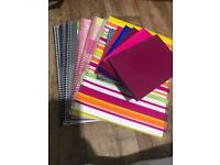 12 brand new notepads, 6 A4 spiral bound lined notepads and 6 small notepads approx. 15x11cms.