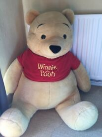 Huge Winnie the Pooh teddy. Perfect for your little one. Great condition.