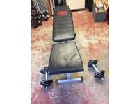 Weight training bench with cast iron dumbells