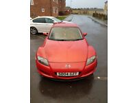 Mazda rx8 in red. Good runner. Recent service