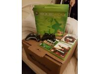 Xbox 360 arcade with 3 controllers and 3 games