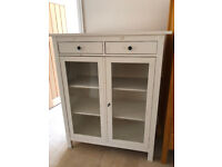 White tall cabinet with glass fronted doors