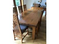 Large rustic dining table and 8 chairs - matching sideboard and bookcase also available