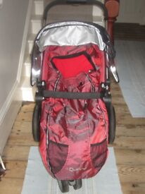 Quinny Buzz Pushchair in pink and matching Foot Muff.