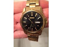 Gold plated seiko solar powered watch