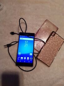 Good condition sony xperia z3 with few cases