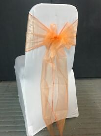 99x burnt orange organza wedding chair sashes - used once. Lycra chair covers listed separately.