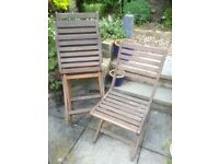 Four folding wooden garden chairs