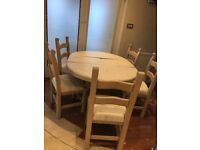 Solid pine extending round kitchen table and 6chairs
