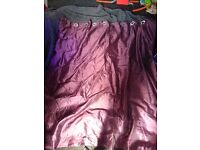 Purple lined eyelet curtains