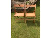 Two solid wood fold up chairs ( can deliver )