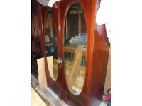 Antique inlaid wardrobe with oval bevel edged mirrors