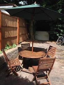 Hard wood garden Table, Chair & Umbrella (adjustable angle) and stand.