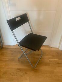 Set of 4 black folding chairs - Ikea