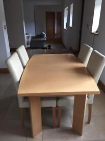 Light wood dining table and 4 cream leather chairs