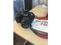 Nikon F50 35mm SLR Film Camera with 35-80mm Lens included is in perfect condition