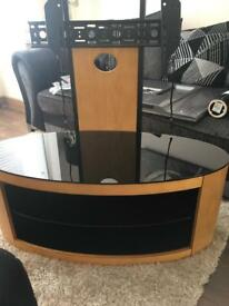 Tv stand with attached Tv bracket