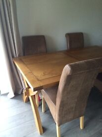 Oak table and stressed faux leather chairs