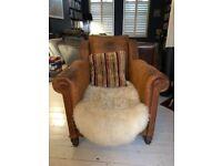 Sumptuous antique brown leather armchair