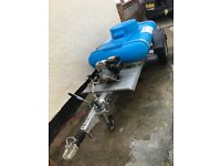 Petrol pressure washer on bowser trailer