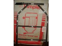 DIMPLEX HEATED TOWEL RAIL.... AS NEW STILL IN BOX ... CHROME . BARGAIN PRICE .