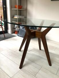 Glass-topped West Elm round dining table