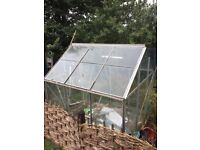 2m by 2m metal framed greenhouse with glass windows and sliding single door